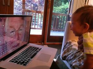 Malcolm Gault-Williams and his first grandchild on Skype video call