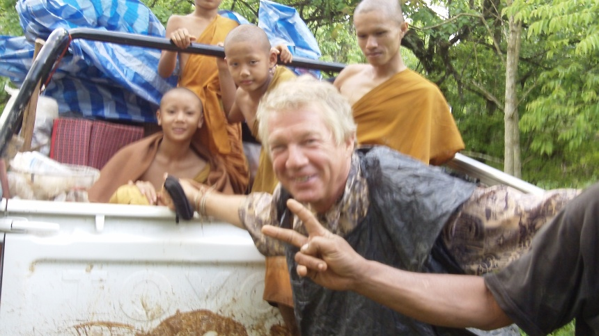 Malcolm Gault-Williams with monks, upcountry, in back of pick-up