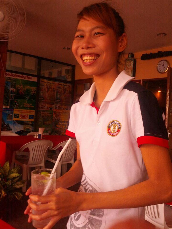 Mook, my waitress, brings a a soda water ...