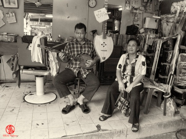 Barber with Mother at shop