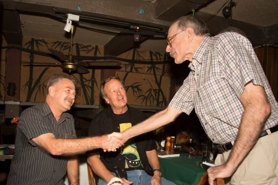 Kevin Cummings looks on as Alan Parkhouse of the Bangkok Post shakes hands with Bangkok author Dean Barrett